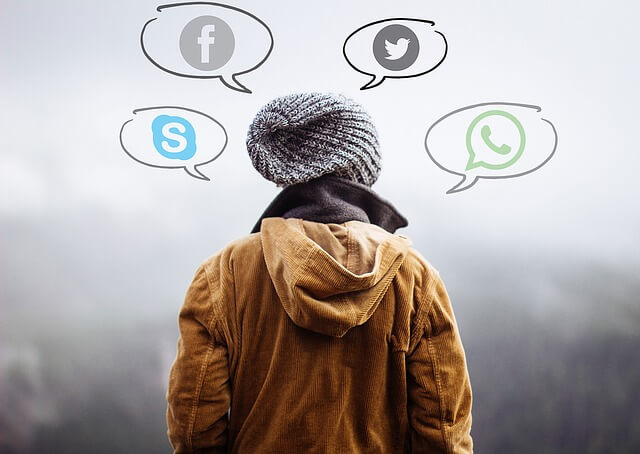 Human using mobile apps - WhatsApp, Twitter, Facebook and Skype