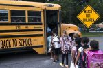 School Students Get on School Bus - Back to School
