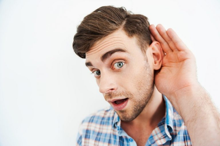 Man cupping his hand behind his ear to hear better some important Instagram hacks and tricks