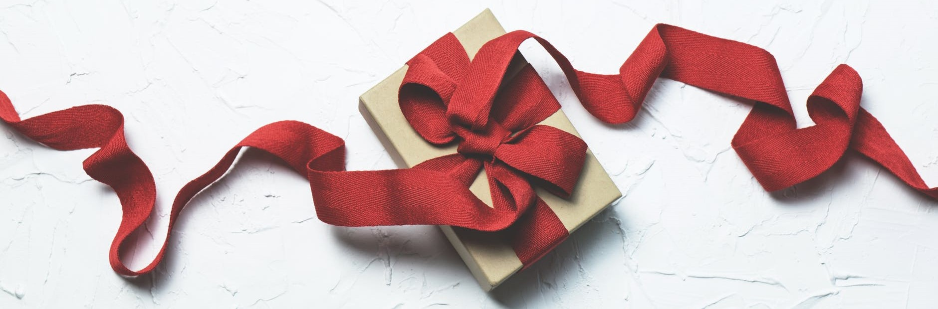 Red gift box with ribbon. Gifts for Christmas