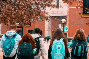 students wearing backpack
