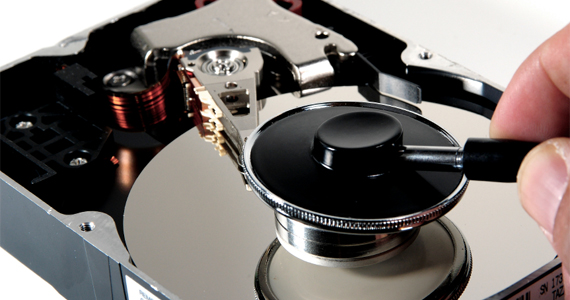 Data Corruption - Hard Drive and Stethoscope. Hard Drive Data Recovery. Hard Drive Fix.
