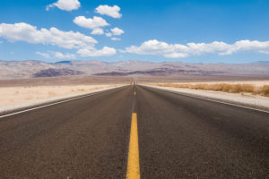 Road Trip to the USA. Desert Road on the way to Furnace Creek in Death Valley, California