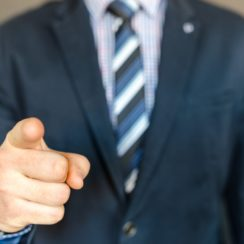 Businessman/Entrepreneur pointing finger at the mistakes