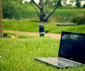 Gray and Black Laptop Computer on Grass Lawn Outdoors