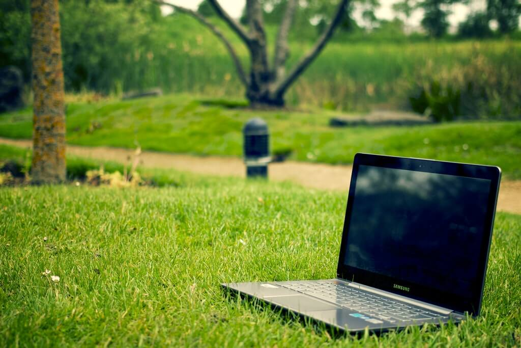 Gray and Black Laptop Computer on Grass Lawn Outdoors. Free Stock Photo