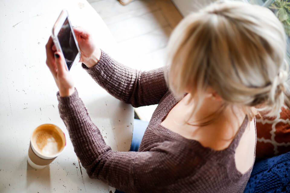 Beautiful Photo of Woman Browsing Smartphone