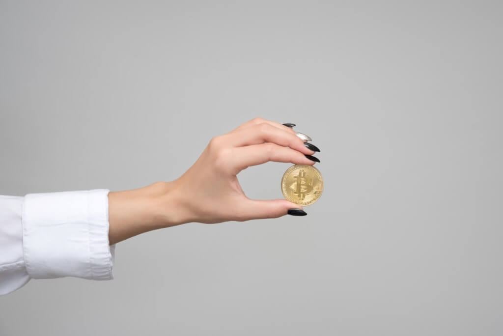 Woman holding a bitcoin cryptocurrency.