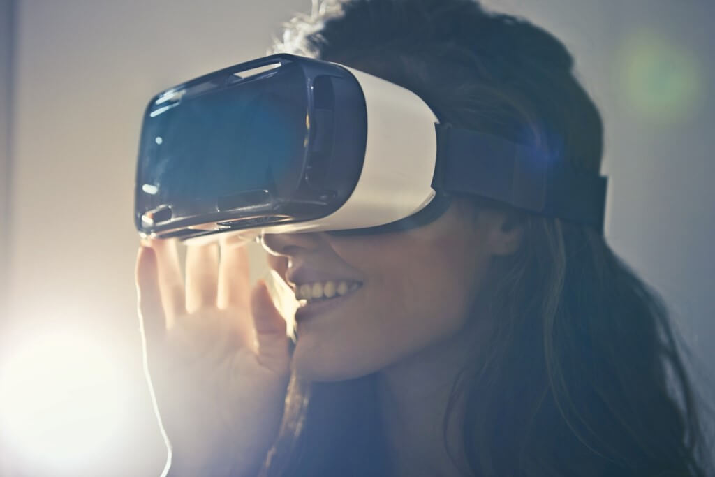 Woman wearing virtual reality goggles. Top Tech Trends in Education - Virtual Reality Technology.