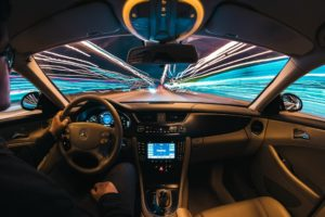 Time lapse photography of man riding car photo – Future Car Technology.