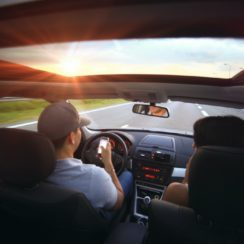 Man Using Smartphone While Driving, Distracted Driving
