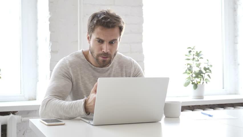 Man Blogging on a Laptop Computer.