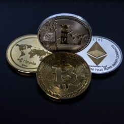 Four Assorted Cryptocurrency Coins - Bitcoin, Ethereum, Litecoin, Ripple.