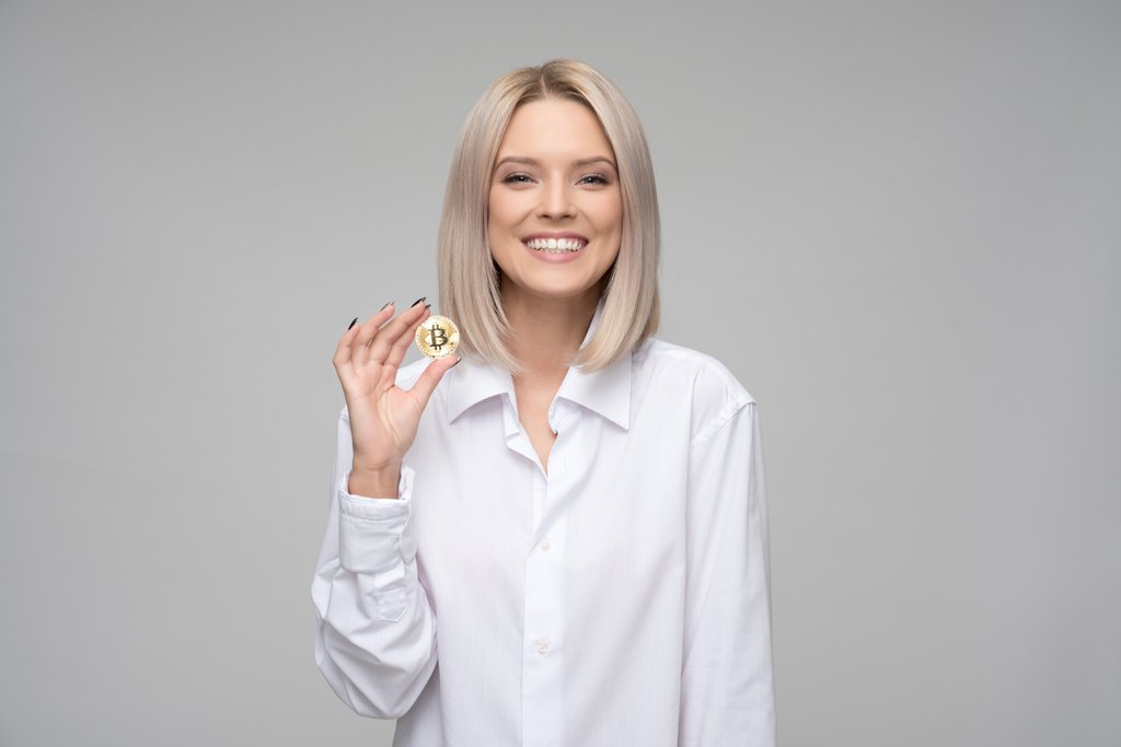 Women Holding Bitcoin Cryptocurrency