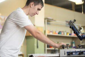 young man screen printing