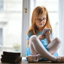 Girl Wearing Blue Dress While Using Smartphone.