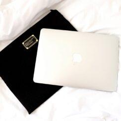 Silver Macbook on Marc Jacobs Black Laptop Case
