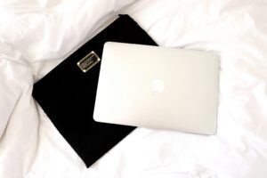 Silver Macbook on Marc Jacobs Black Laptop Case