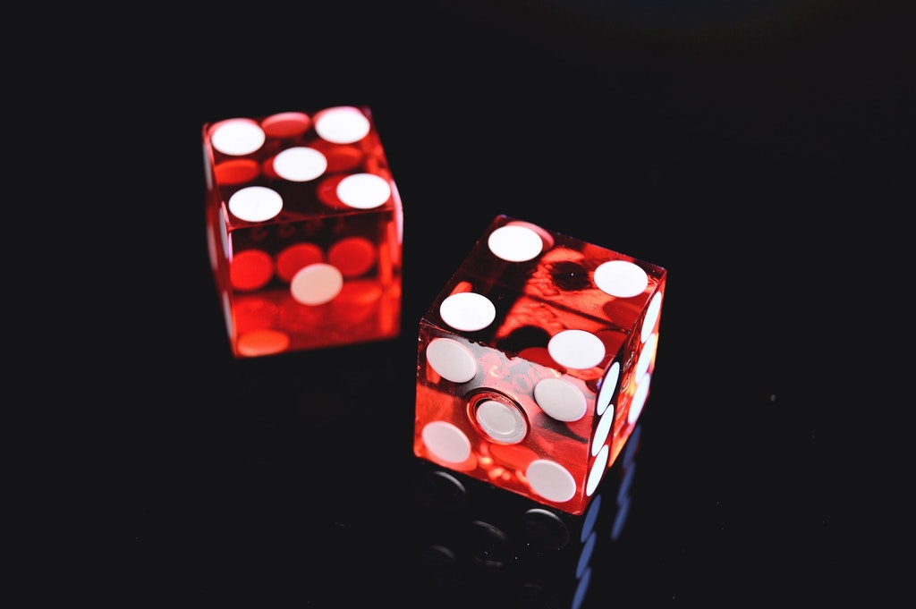 Closeup photo of two red dices showing 4 and 5.