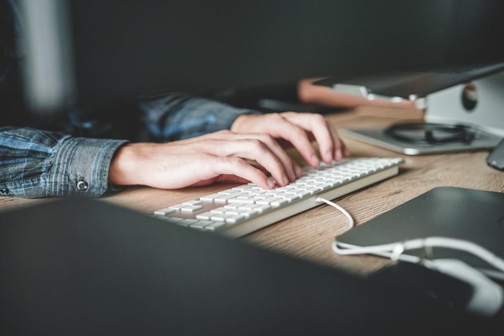 Person using computer keyboard photo
