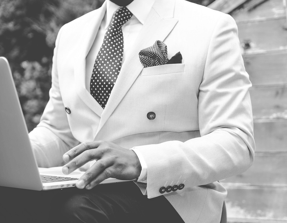 Man in Black and White Suit