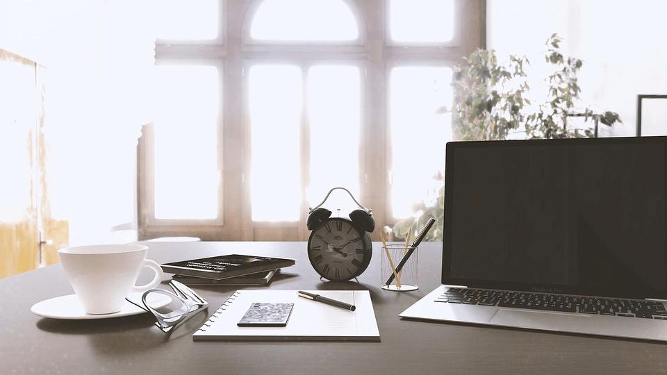 Work Desk With Laptop Computer, Alarm Clock.