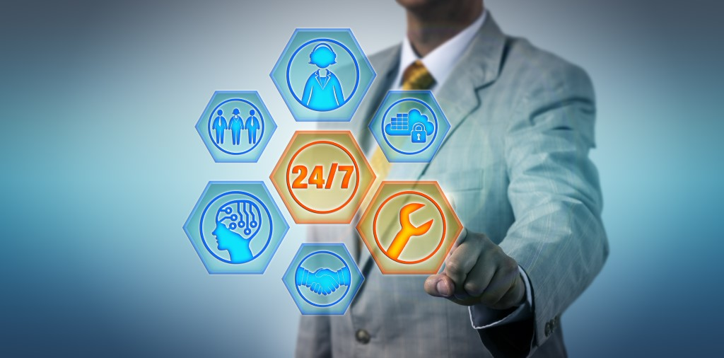 Business Manager Activating 24/7 Managed Services. Information technology and business concept for managed services, outsourcing, help desk, remote assistance.