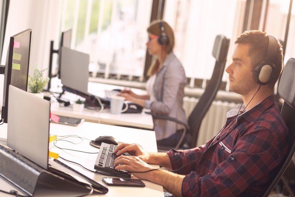 In-house software development and IT support team working