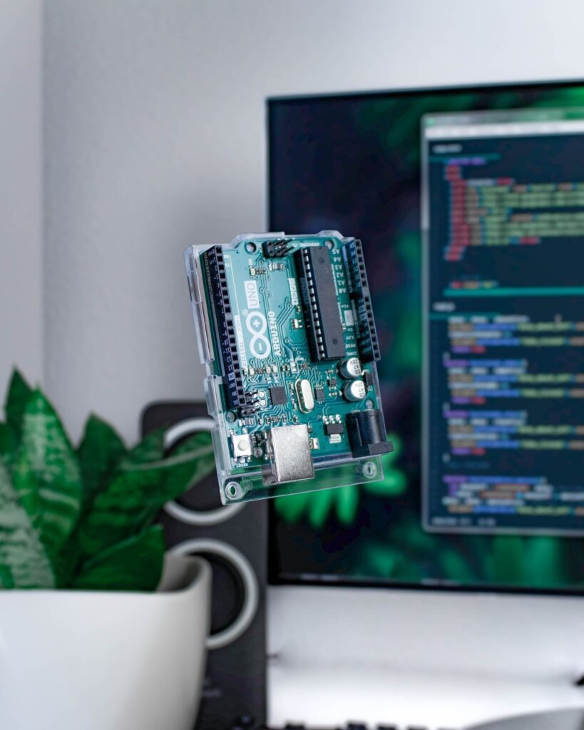 Arduino Board With Some Code in the Background