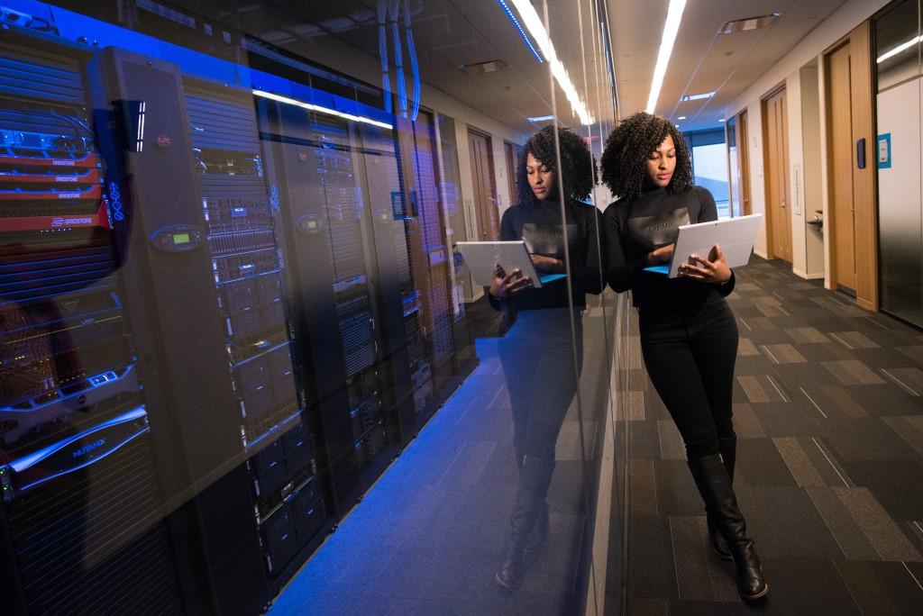 Standing Woman Holding Laptop, Data Center, SQL Server, Database Engineer, DBA