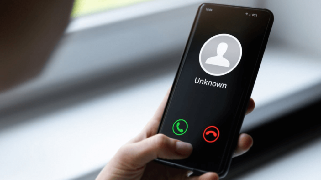 A smartphone with the Unknown number dialing it. Spam call from an Unknown number.