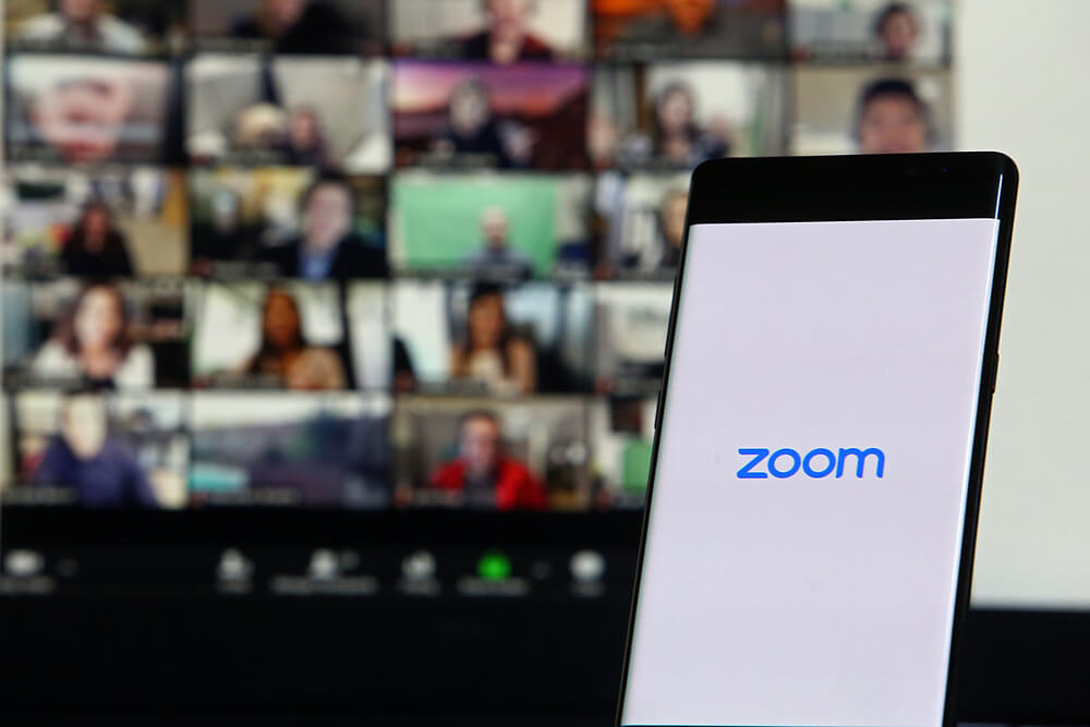 Zoom logo and Zoom meeting on Laptop